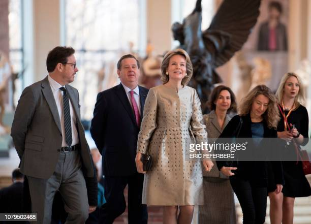 Queen Mathilde of Belgium walks alongside director general of the Royal Museums of Fine Arts of Belgium, Michel Draguet , as she arrives at the Petit...