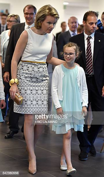 Queen Mathilde of Belgium walks with a child during a visit to the Centre for Human Genetics of the Catholic University of Leuven on June 22 in...