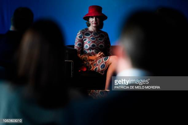 Queen Mathilde of Belgium watches a movie clip of the Oceano Azul Foundation during their visit to Lisbon's Oceanarium on October 23 in Lisbon, on...