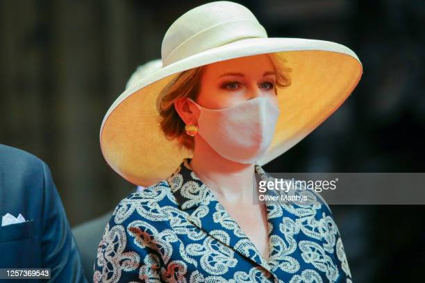 Queen Mathilde of Belgium wears a face mask as she attends the Te Deum which takes place on the occasion of the National Day in the Cathedral of...