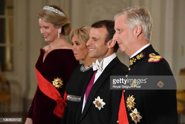 Queen Mathilde, President of France Emmanuel Macron, King Philip of Belgium and First Lady of France Brigitte pose for the official photo prior to...