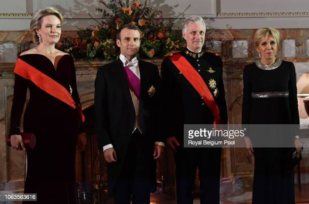 Queen Mathilde, Princess Astrid, President of France Emmanuel Macron, King Philip of Belgium, Prince Laurent and First Lady of France Brigitte pose...