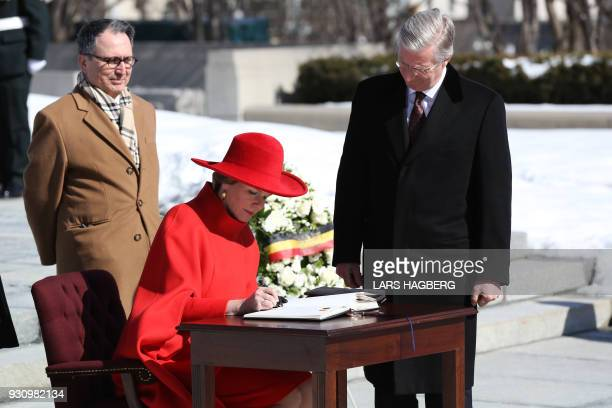 Queen Mathilde signs a book of condolences after King King Philippe of Belgium laid a wreath at the Tomb of the Unknown Soldier during the state...