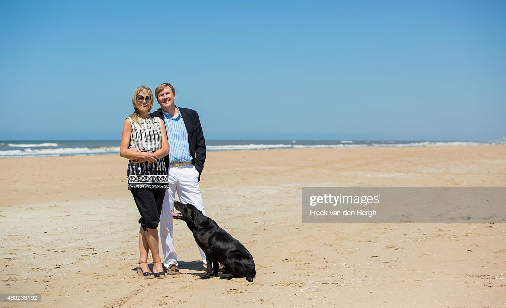 Queen Maxima and King Willem-Alexander of The Netherlands and one of their dogs pose for pictures on July 10, 2015 in Wassenaar, Netherlands.