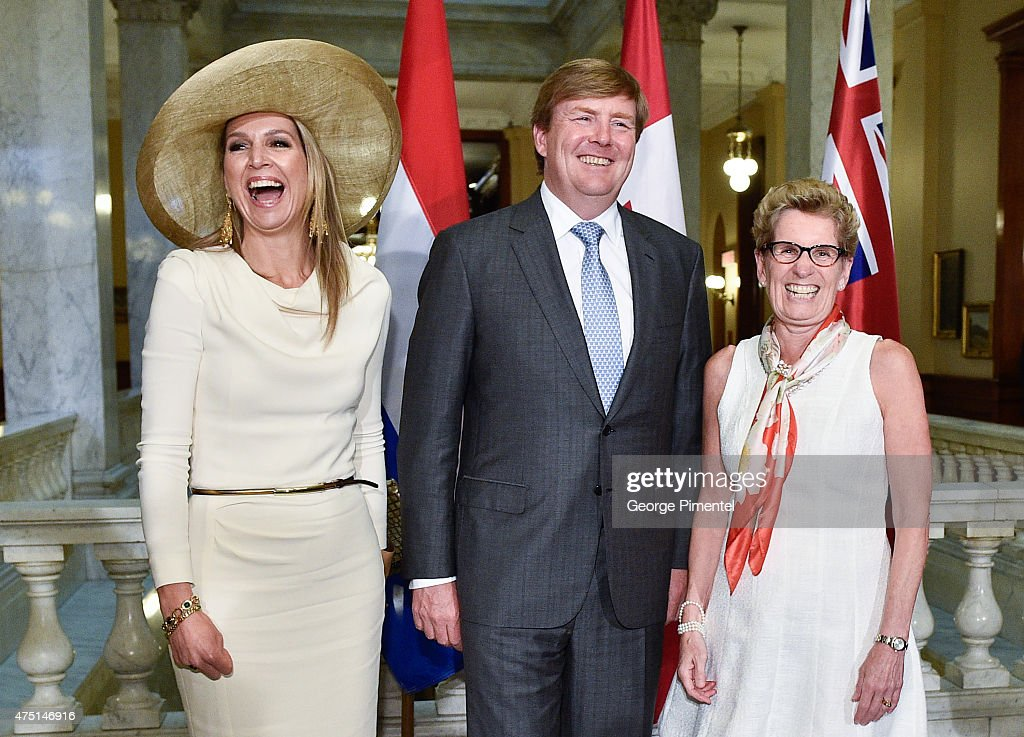 Queen Maxima and King Willem-Alexander of The Netherlands and Premier of Ontario Kathleen Wynne pose at Queen's Park during state visit to Canada on May 29, 2015 in Toronto, Canada.