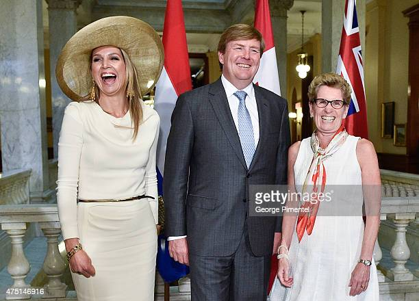 Queen Maxima and King WillemAlexander of The Netherlands and Premier of Ontario Kathleen Wynne pose at Queen's Park during state visit to Canada on...