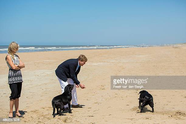 Queen Maxima and King WillemAlexander of The Netherlands and their dogs pose for pictures on July 10 2015 in Wassenaar Netherlands