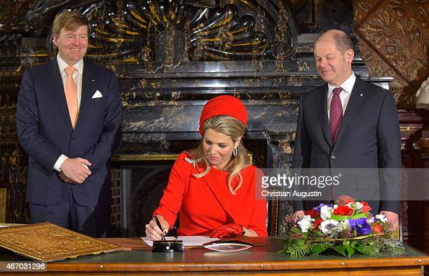Queen Maxima and King Willem-Alexander of The Netherlands attend by mayor Olaf Scholz sign the golden book of the city of Hamburg at the townhall of...