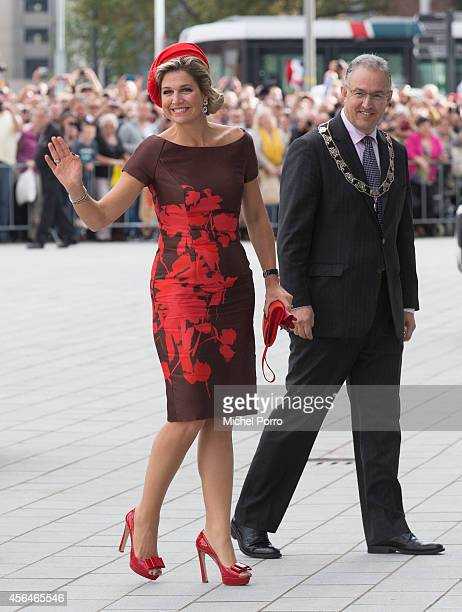 Queen Maxima and Rotterdam mayor Ahmed Abutaleb of The Netherlands attend the opening of the new Markthal on October 1 2014 in Rotterdam Netherlands...