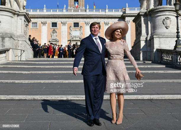 Queen Maxima of Netherlands and King Willem-Alexander pose in front of Rome City Hall after a meeting with Rome's mayor Virginia Raggi on June 20,...