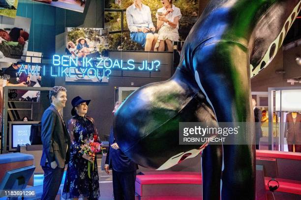 Queen Maxima of Netherlands speaks with Dutch artist Florentijn Hofman , the maker of the 8.5-meter-high artwork 'A Handstand' , at the Humania...