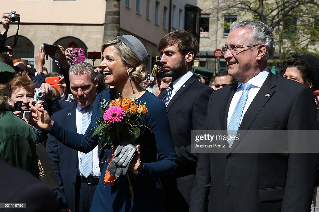 Queen Maxima of the Netherlands and Bavarian Minister of the Interior Joachim Herrmann greet bystanders on Townhall square on April 14, 2016 in Nuremberg, Germany. King Willem-Alexander and Queen Maxima are on a two-day visit in Bavaria to strengthen the relationship between Bavaria and the Netherlands.