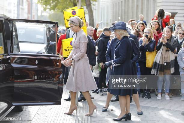 Queen Maxima of the Netherlands and Britain's Camilla Duchess of Cornwall leave The Dutch Ambassadors Residence in London on October 23 at the start...
