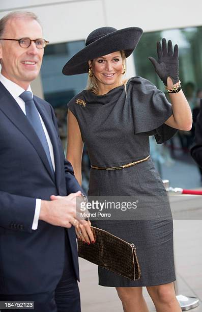 Queen Maxima of The Netherlands and Cees 't Hart attends the opening of the Royal Friesland Campina Innovation Centre on October 16 2013 in...