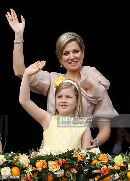 Queen Maxima of the Netherlands and daughter Princess Alexia appear on the balcony of the Royal Palace to greet the public after the abdication of...