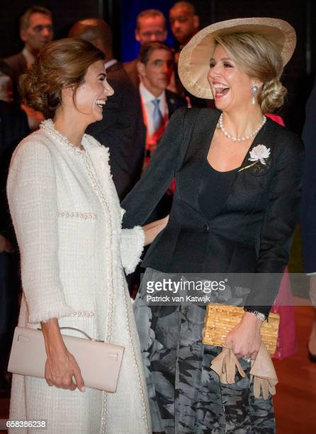Queen Maxima of The Netherlands and Juliana Awada share a joke as they visit the Hockey Clinics in the Beurs van Berlage on March 27 2017 in...