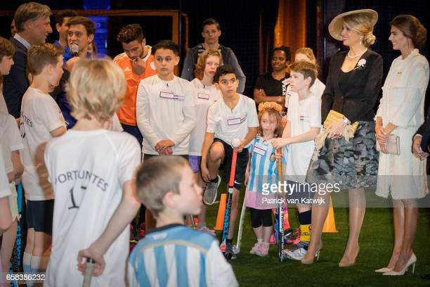 Queen Maxima of The Netherlands and Juliana Awada visit the Hockey Clinics in the Beurs van Berlage on March 27 2017 in Amsterdam The Netherlands The...
