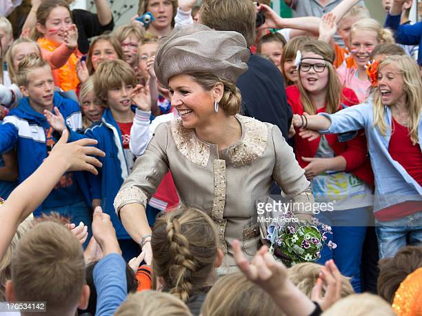 Queen Maxima of the Netherlands and King Willem-Alexander of the Netherlands are greeted by well-wishers during an official visit to downtown Joure...