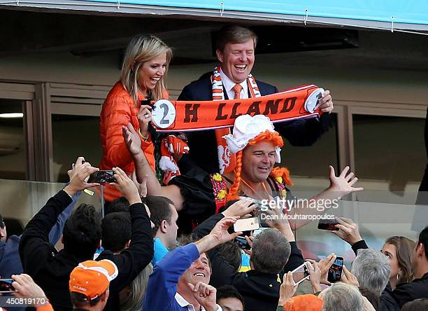 Queen Maxima of the Netherlands and King WillemAlexander of the Netherlands celebrate their team's victory with fans after the 2014 FIFA World Cup...