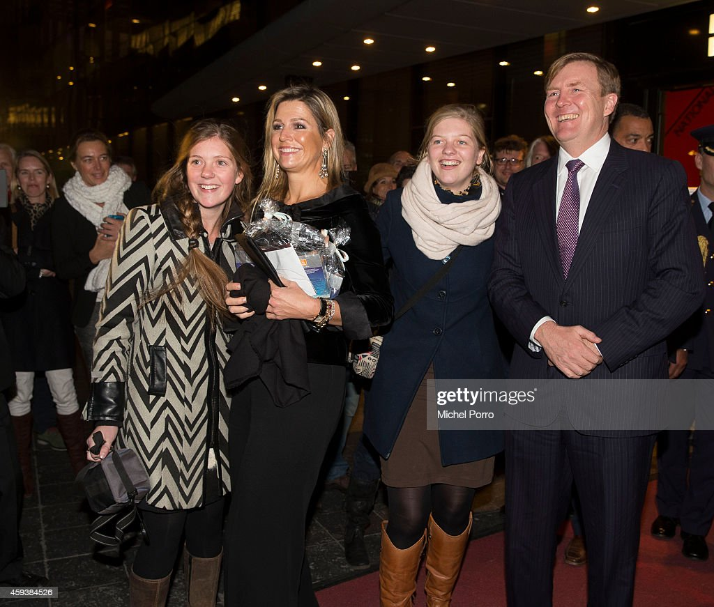 Queen Maxima of The Netherlands and King Willem-Alexander of The Netherlands pose with royalty fans who gave them chololate while leaving the Residentie Orkest (Orchestra) 110th Anniversary on November 21, 2014 in The Hague, The Netherlands.