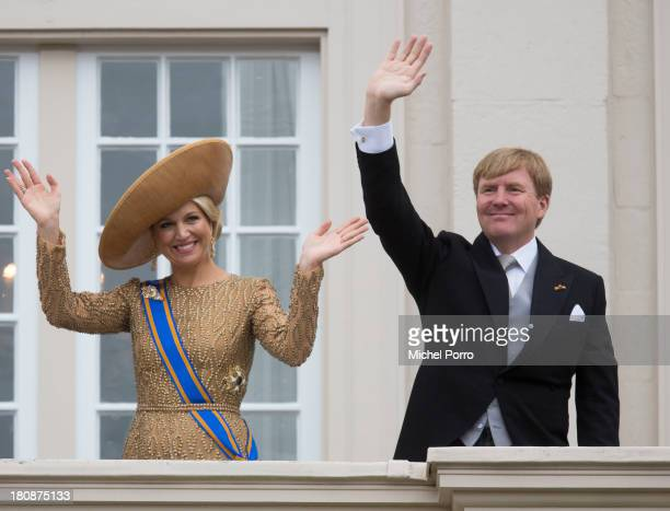 Queen Maxima of The Netherlands and King Willem-Alexander of The Netherlands wave from the balcony of the Noordeinde Palace during celebrations for...