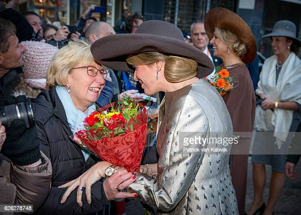 Queen Maxima of the Netherlands and Queen Mathilde of Belgium meet with wellwishers during their visit to the Flemish culture house Bakke Grond on...