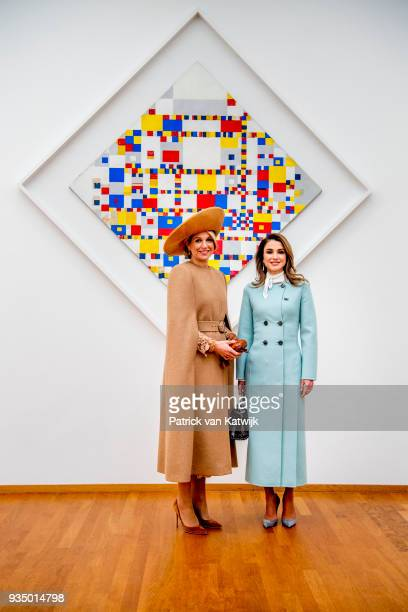 Queen Maxima of The Netherlands and Queen Rania of Jordan visit the Gemeentemuseum and pose in front of the Victory Boogie Woogie on March 20 2018 in...