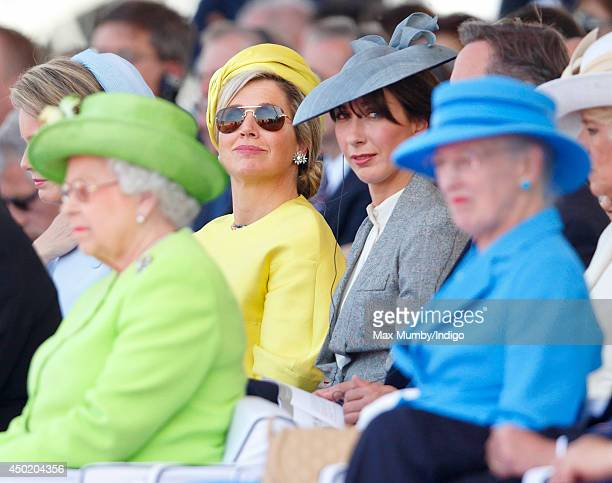 Queen Maxima of The Netherlands and Samantha Cameron sit behind Queen Elizabeth II and Queen Margrethe of Denmark as they attend the International...