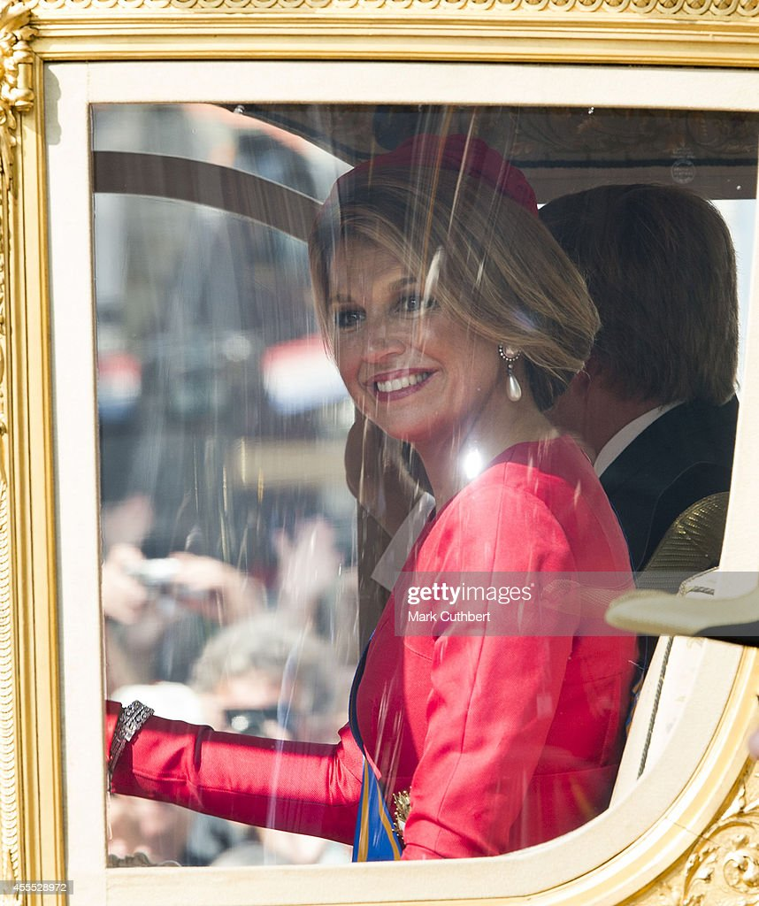 Queen Maxima of the Netherlands arrives in The Gold Coach back at The Noordeinde Palace during Princes day celebrations on September 16, 2014 in The Hague, Netherlands.