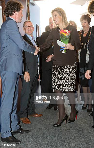 Queen Maxima of The Netherlands attends an evening with parents discussing financial education at elementary school The Archipel on April 14, 2014 in...