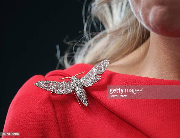 Queen Maxima of the Netherlands, brooch detail, is pictured at the Fischautkionshalle during their state visit on March 20, 2015 in Hamburg, Germany.