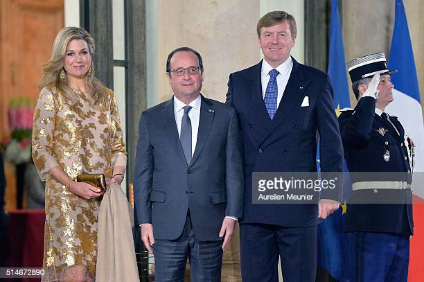 Queen Maxima of The Netherlands French President Francois Hollande and King WillemAlexander of The Netherlands pose in front of the Elysee Palace...