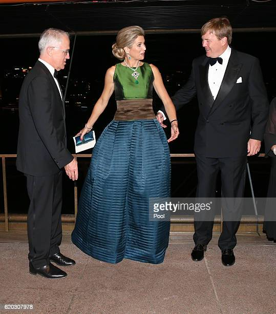 Queen Maxima of the Netherlands gestures to her husband King Willem-Alexander as they arrange positions for a group photograph as Australian Prime...