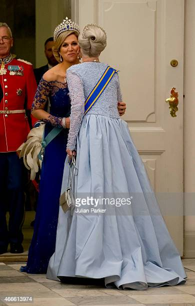 Queen Maxima of the Netherlands greets Queen Margrethe of Denmark on arrival for a State Banquet at Christiansborg Palace during the state visit of...