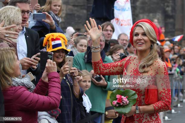 Queen Maxima of The Netherlands greets supporters upon her arrival at the Porta Nigra a magnificent 2ndcentury Roman city gate on October 11 2018 in...