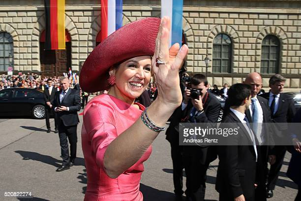 Queen Maxima of the Netherlands greets the crowd at Munich Residenz on April 13, 2016 in Munich, Germany. King Willem-Alexander and Queen Maxima are...