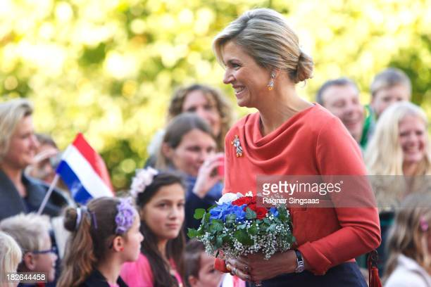 Queen Maxima of The Netherlands is greeted by wellwishers as she arrives at the Royal Palace during an official visit to Oslo on October 2 2013 in...