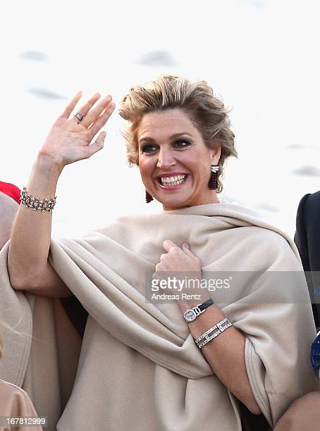 Queen Maxima of The Netherlands is seen aboard the King's boat for the water pageant to celebrate the inauguration of King Willem Alexander of the...