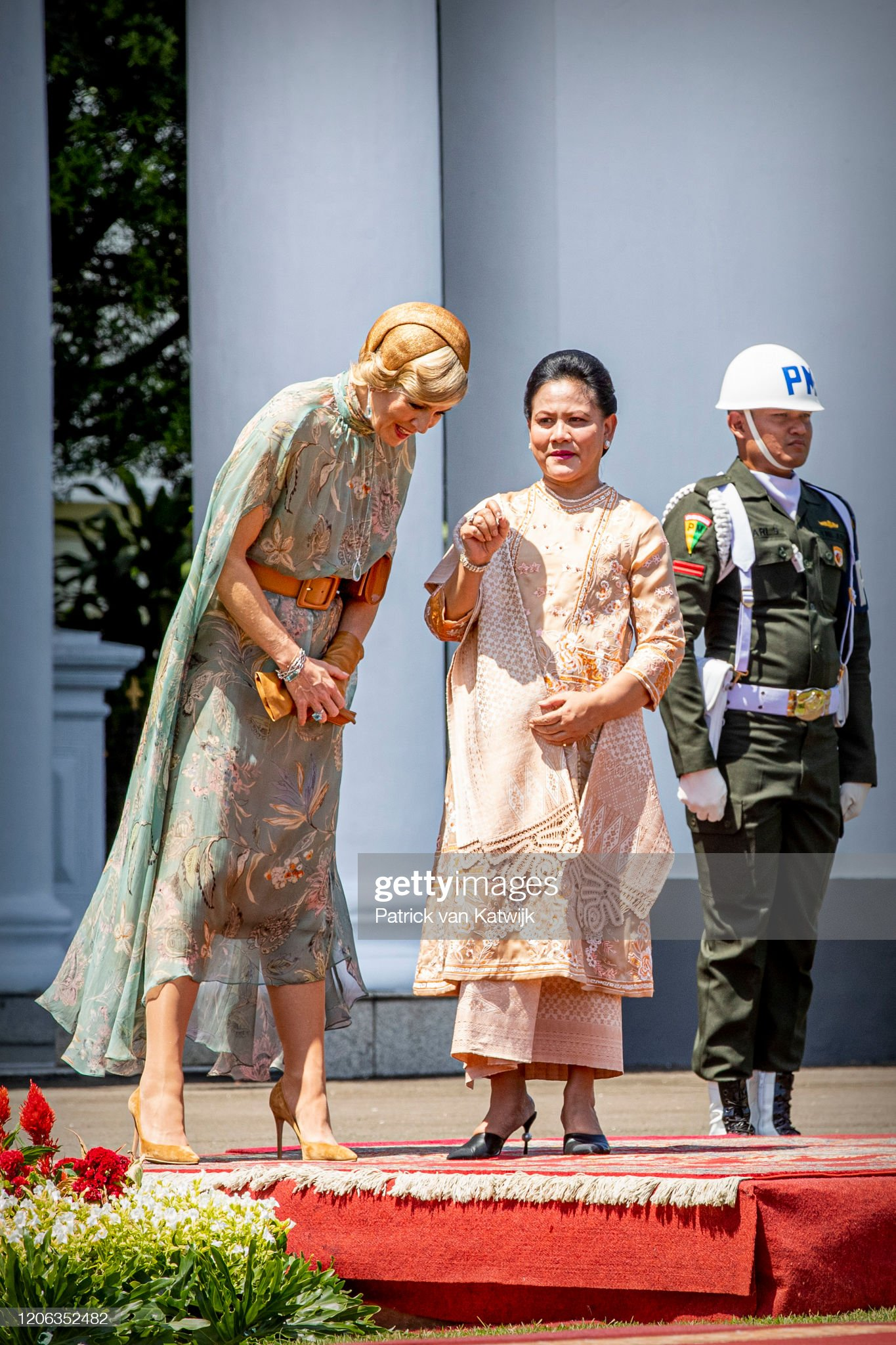 https://media.gettyimages.com/photos/queen-maxima-of-the-netherlands-is-welcomed-by-president-jcand-his-picture-id1206352482?s=2048x2048