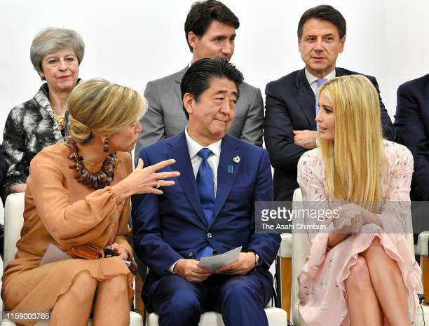 Queen Maxima of the Netherlands, Japanese Prime Minister Shinzo Abe, and Advisor to U.S. President Ivanka Trump discuss during the women's...