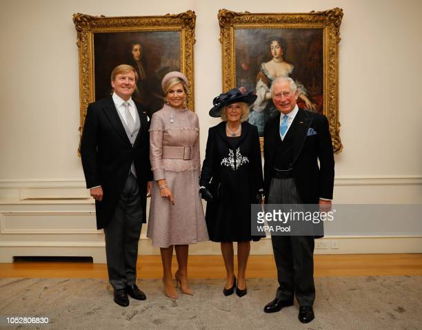 Queen Maxima of the Netherlands King WillemAlexander of the Netherlands Camilla Duchess of Cornwall and Prince Charles Prince of Wales pose together...