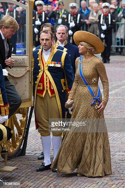 Queen Maxima of The Netherlands leaves the golden chariot that she arrived in during celebrations for Prinsjesdag on September 17 2013 in The Hague...