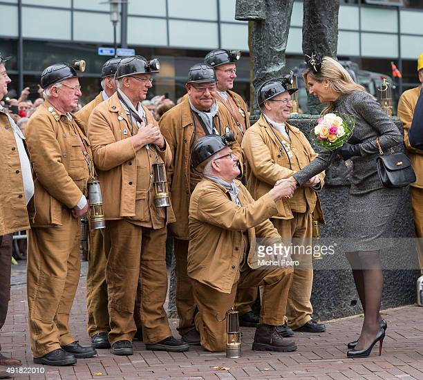 Queen Maxima of The Netherlands meets with retired miners near the Miner's Monument d'r Joep during a visit to the former mining region on October 8...