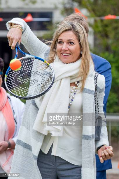 Queen Maxima of The Netherlands plays tennis during the King's Games youth sport day at De Vijfmaster school on April 21 2017 in Veghel Netherlands