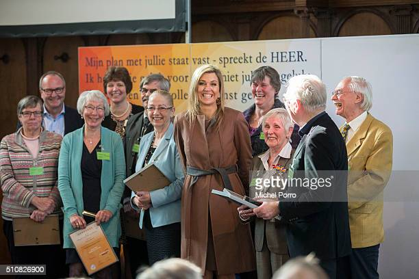 Queen Maxima of The Netherlands poses with volunteers during the five year anniversary celebration of Schulhulpmaatje on February 16, 2016 in Leiden,...