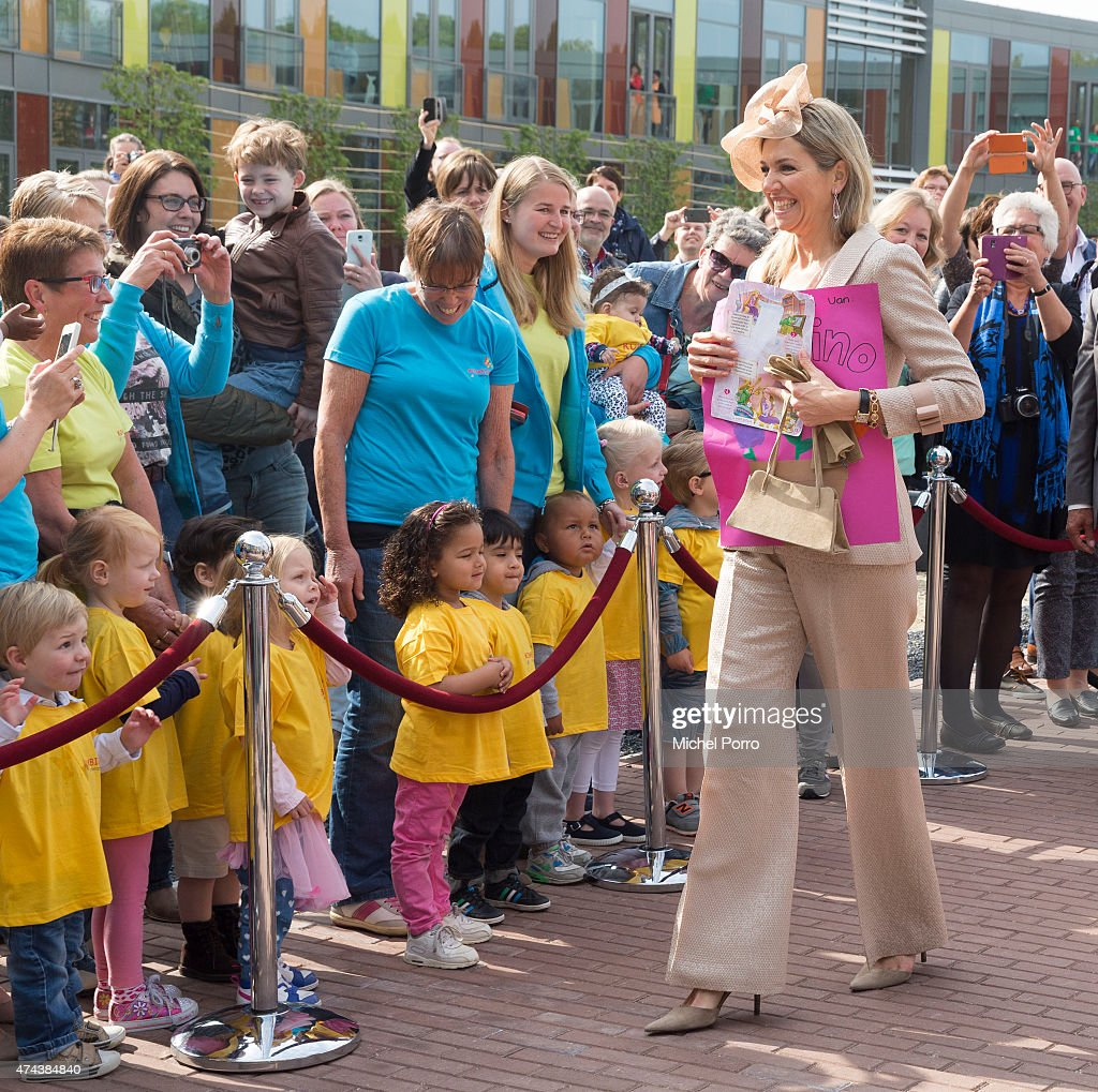 Queen Maxima of The Netherlands receives a drawing before opening the new Koninklijke Kentalis diagnostic care education centre for people with a severe hearing and or vision disability on May 22, 2015 in Zoetermeer, Netherlands.