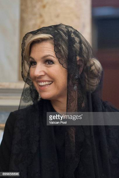 Queen Maxima of the Netherlands receives at the Apostolic Library the commander's baton attributed to William of Orange from the Superior General of...