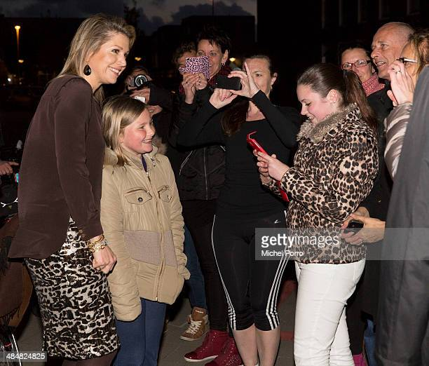 Queen Maxima of The Netherlands, Romy Teeuwissen and Lily Verhoeven have their picture taken at the Archipel elementary school after an evening with...
