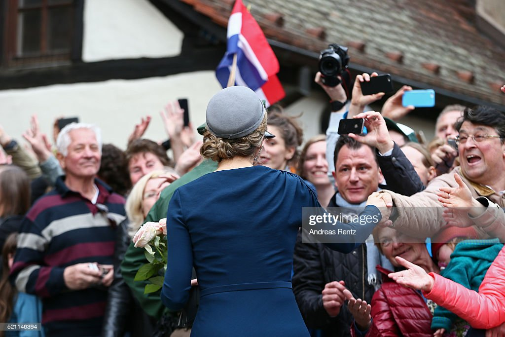 Queen Maxima of the Netherlands shakes hands with bystanders after their visit of Albrecht Duerer's House on April 14, 2016 in Nuremberg, Germany. King Willem-Alexander and Queen Maxima are on a two-day visit in Bavaria to strengthen the relationship between Bavaria and the Netherlands.