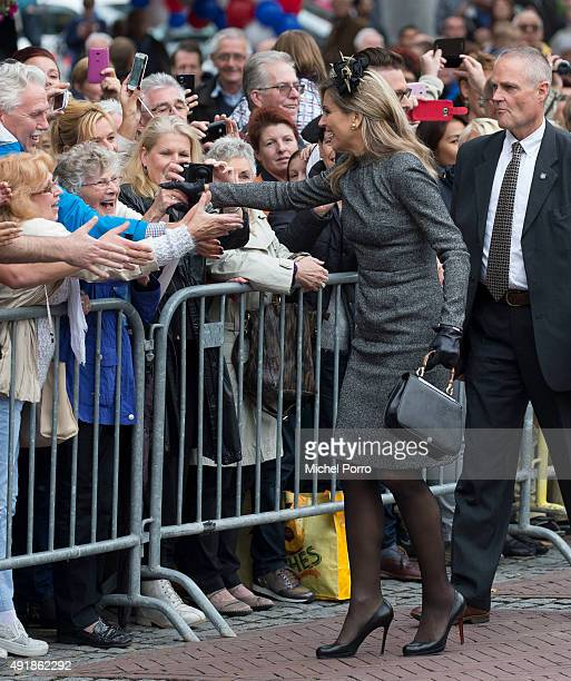 Queen Maxima of The Netherlands shakes hands with people in the crowd during a visit to the former mining region on October 8 2015 in Geleen...